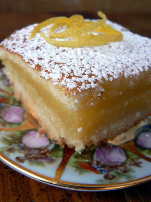 Lemon bars garnished with zest